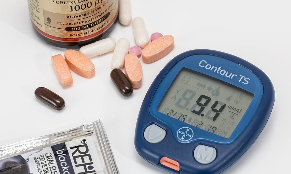 diabetes blood glucose monitor and assorted vitamins