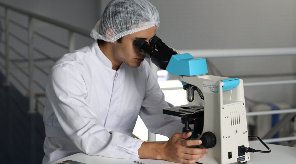 lab worker using microscope